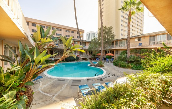 Welcome To Cal Mar Hotel Suites - Lush Courtyard and Pool